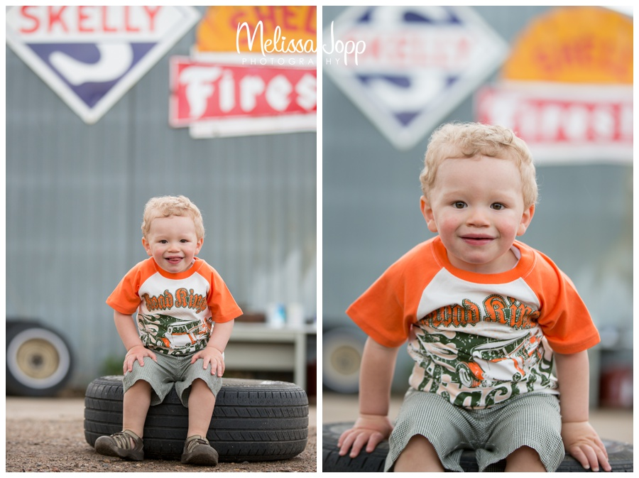 old signs at junk yard and little boys photo session with waconia mn family photographer
