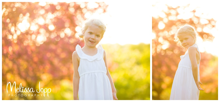 sun flare and apple blossoms girl picture session with chanhassen mn family photographer