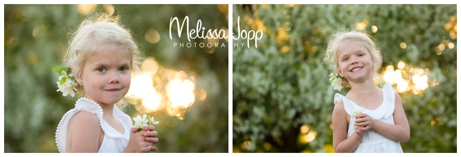 white apple blossoms in spring with portrait photographer in chanhassen mn