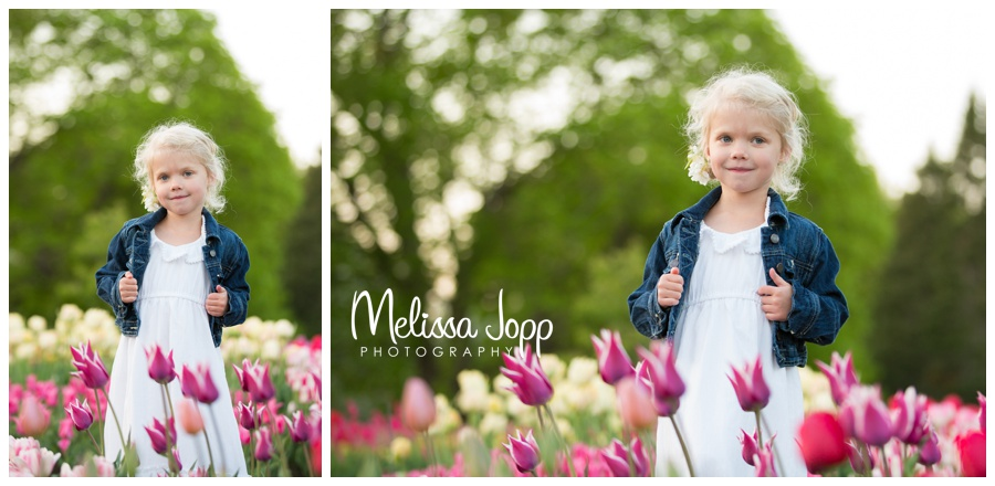 little girls and tulips at minnesota landscape arboretum with photographer in chanhassen mn
