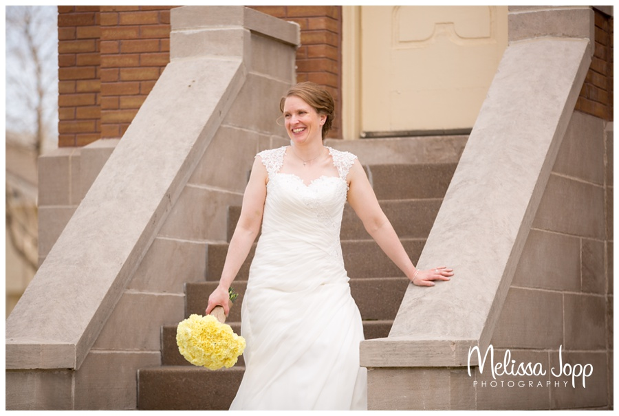 candid shot of bride laughing victoria mn wedding photographer