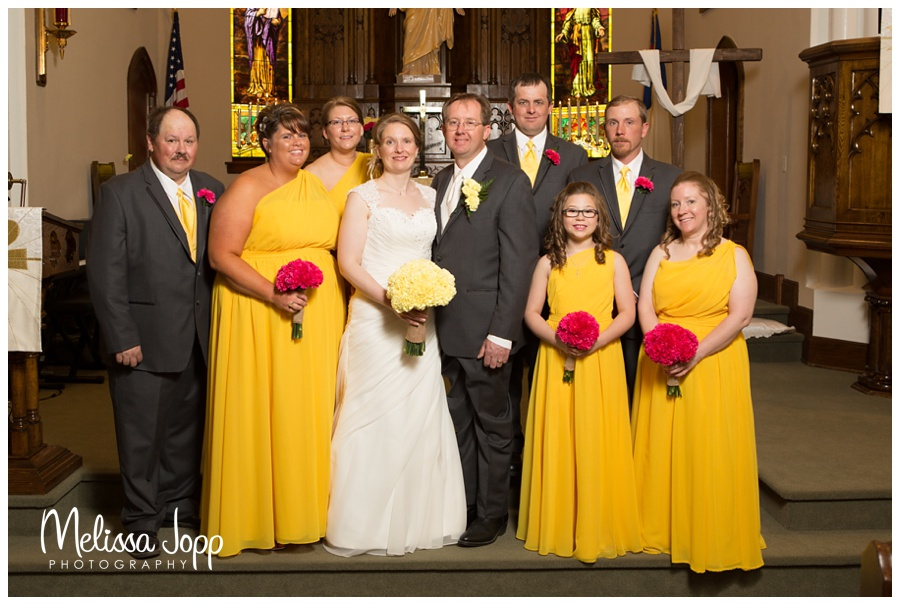 mn wedding photographer church pictures with wedding party yellow and pink