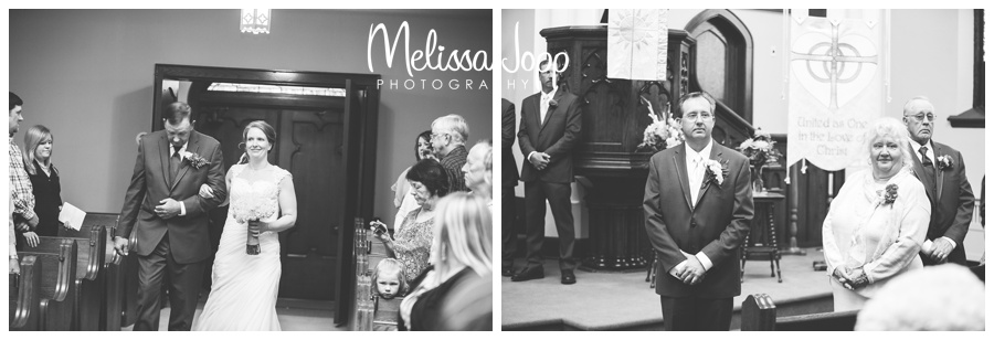 bride walking down aisle with Dad and groom looking at her mayer mn wedding photographer