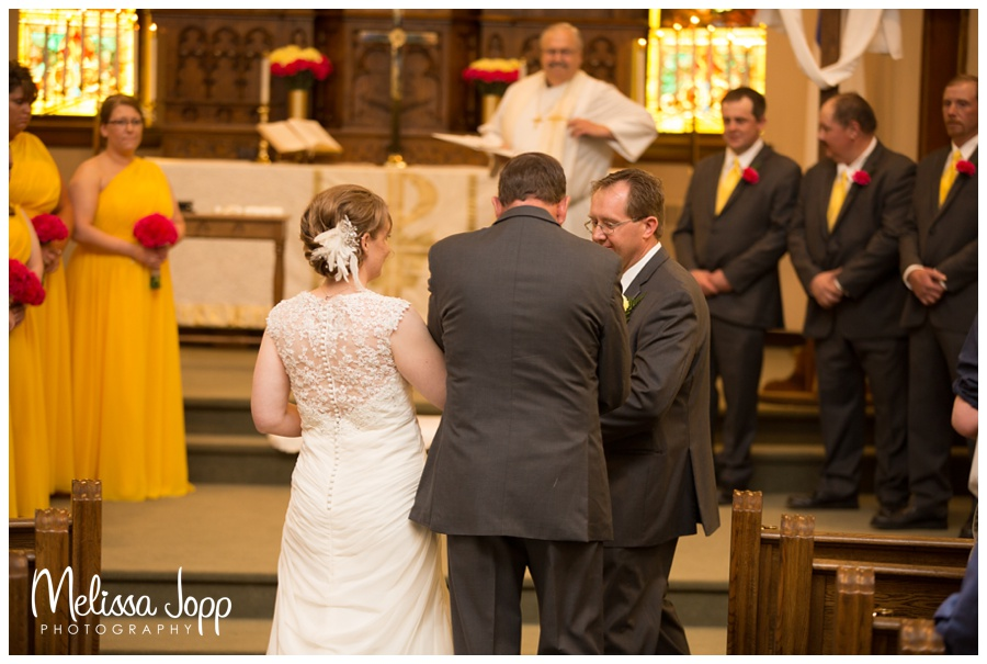dad giving daughter away church wedding mn wedding pictures