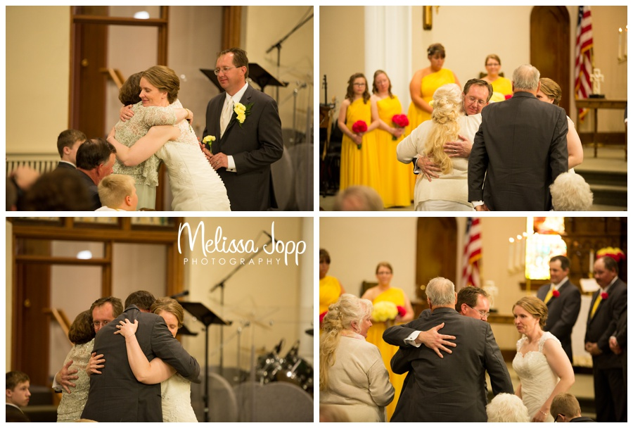 hugging mom and dad during wedding ceremony mn wedding