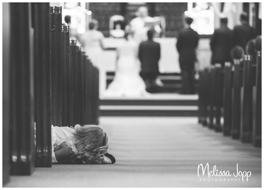 every little girls dream picture of girl looking at bride and groom getting married mn wedding photographer
