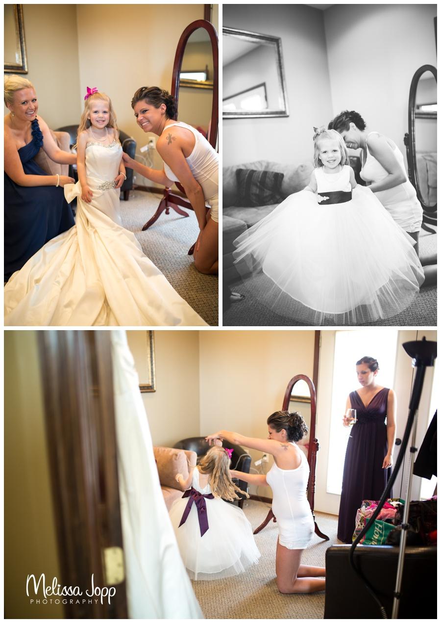 flower girl in brides dress hutchinson mn wedding photographer