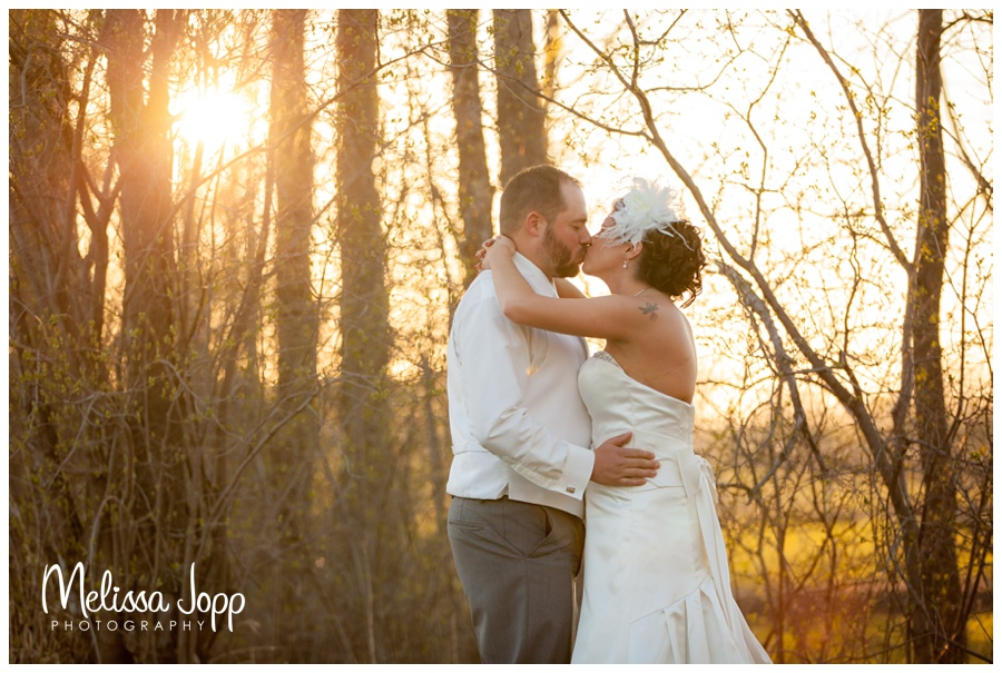 sunset pictures with bride and groom at crow river winery with mn wedding and engagement photographer