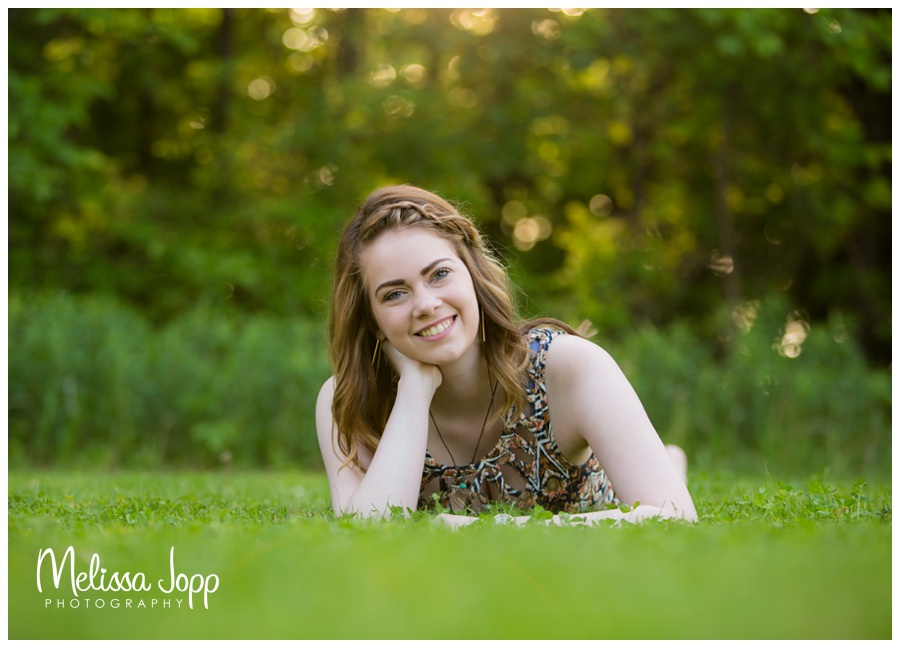 beautiful light shown in senior pictures by a lake with senior photographer in chanhassen mn