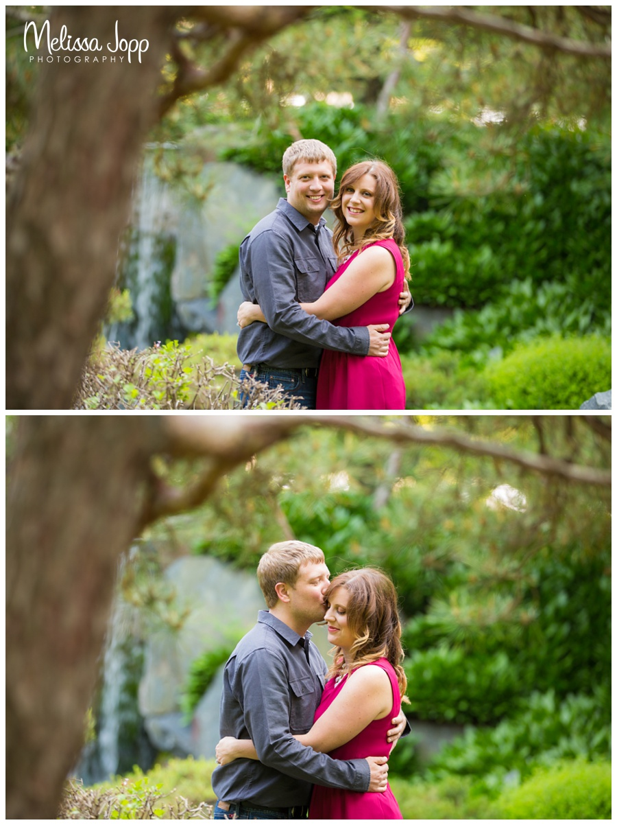 kissing by the fountain engagement session at mn landscape arboretum