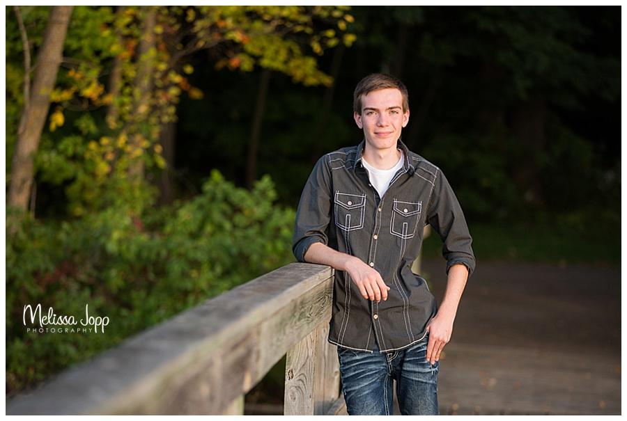 male senior pictures on a bridge chanhassen mn
