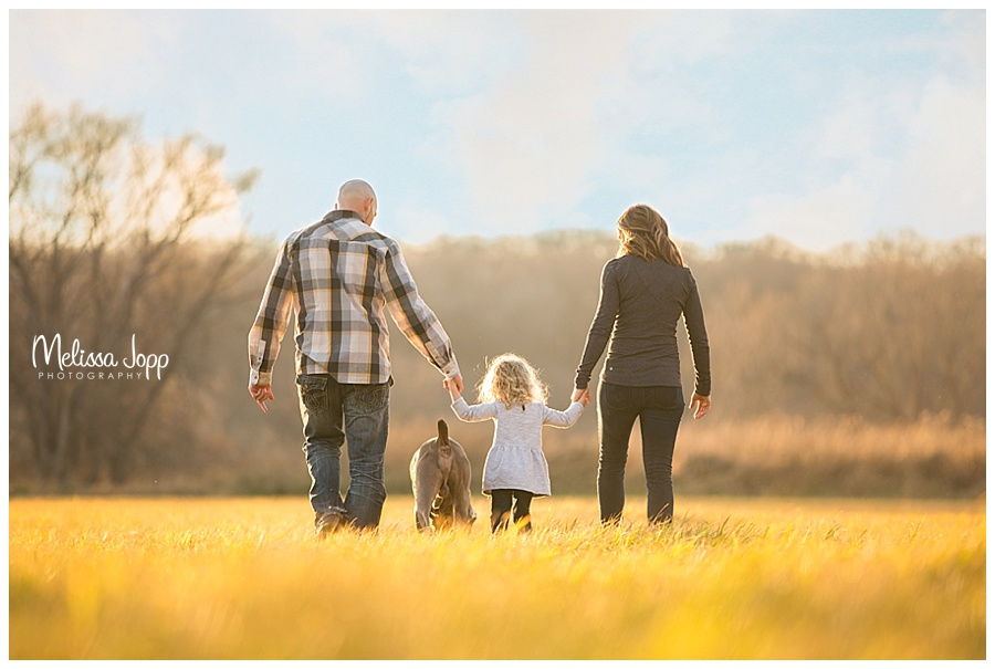 family pictures walking through a field carver county mn