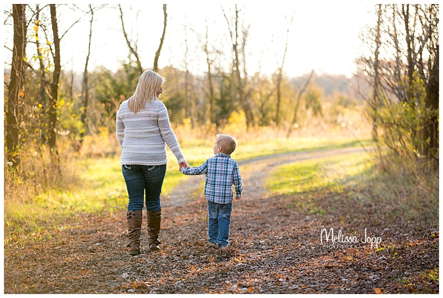 mother and son walking down a path carver county mn