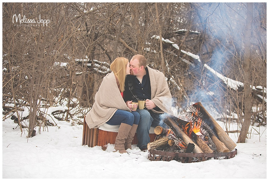 winter engagement pictures by campfire mn