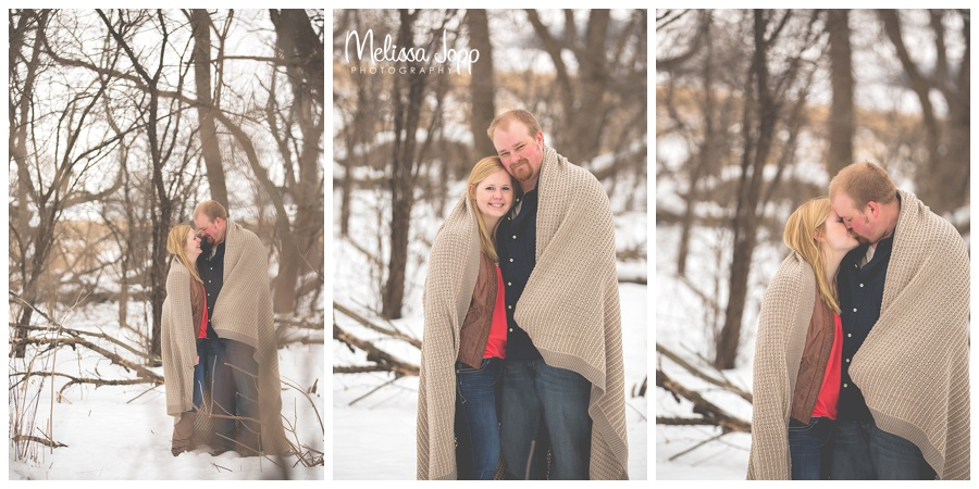 winter engagement pictures with blanket mn