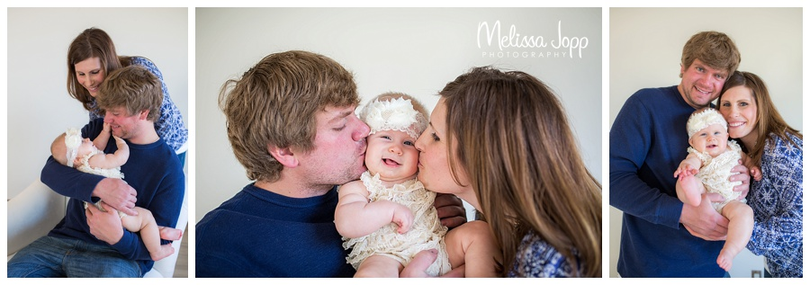 mom and dad kissing baby victoria mn