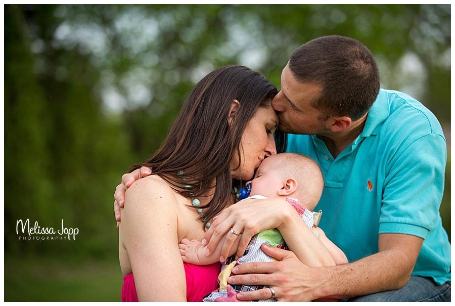 mom and dad kissing baby howard lake mn