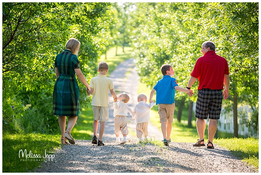 family walking down country path mn