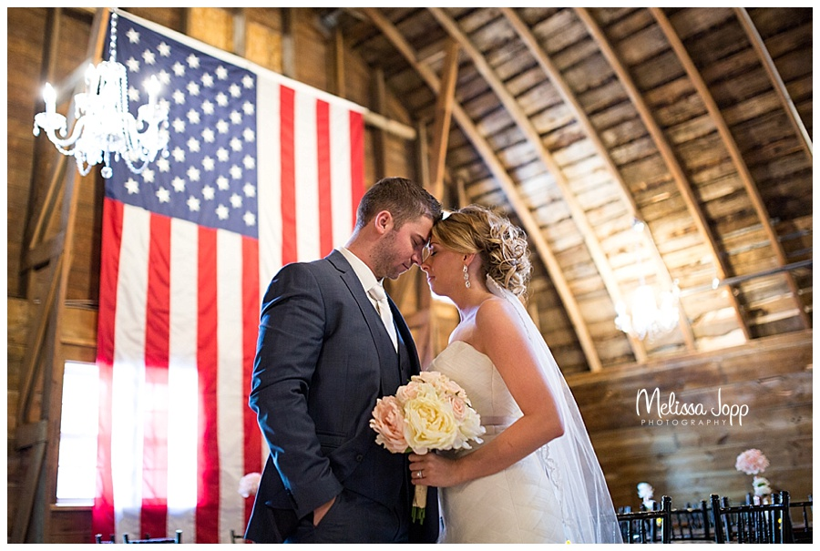 bride and groom with flag mn